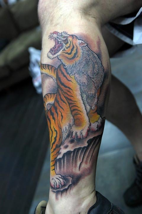 A roaring Japanese traditional tattoo by Mr Ami James himself.