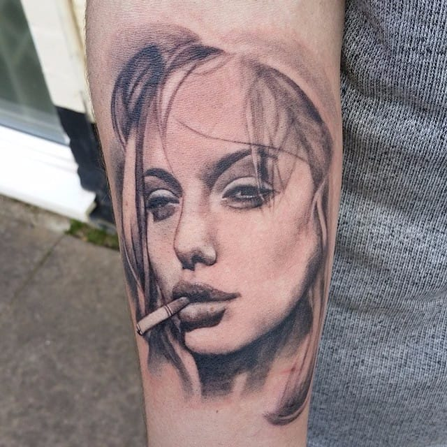 10 Enticing and Fierce Angelina Jolie Tattoos