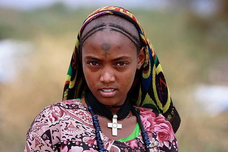 A Tigrian girl with a face tattoo in Africa. Source: photography by Patricia Snook.