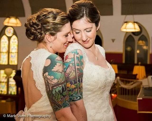 Yes, these ladies are a married couple, and their tattoos are going strong as well