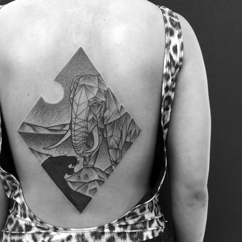 Gorgeous back tattoo by Jaya Suartika.