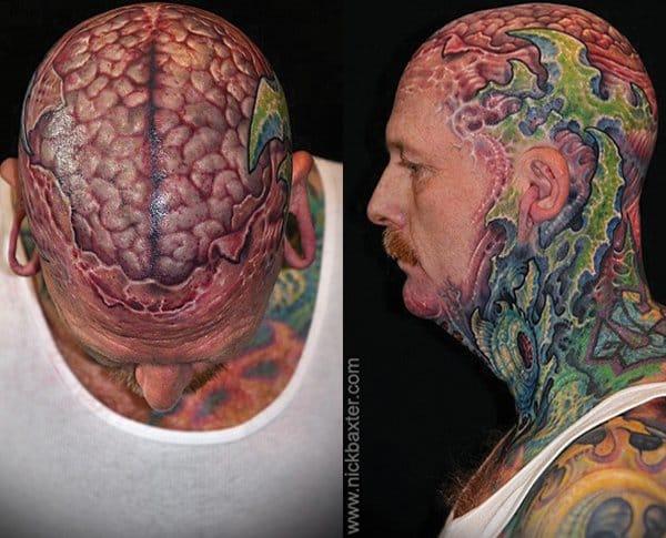 Gut-wrenching brain scalp tattoo, part of an impressive biomechanical tattoo by Nick Baxter.