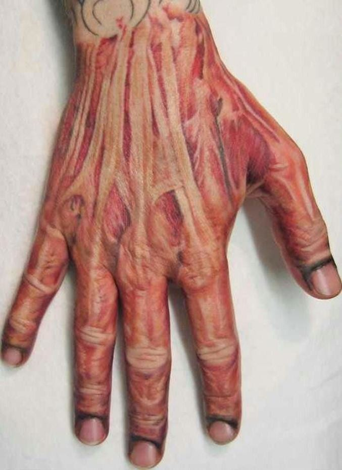 Terrific skinned effect for this hand tattoo by Benjamin Moss...