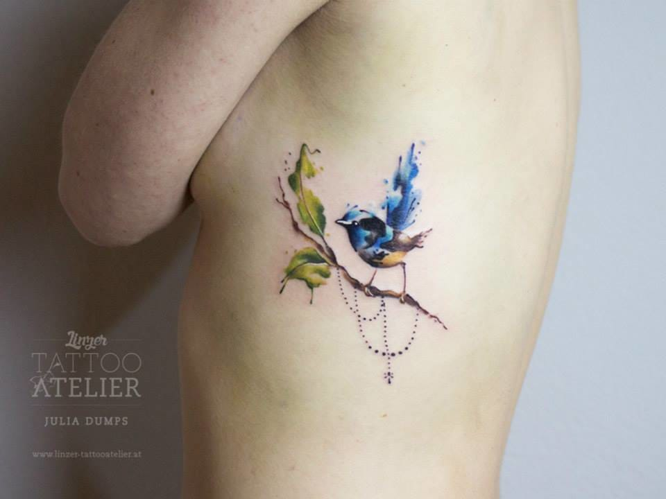 Lovely watercolor bird on its branch by Julia Dumps.