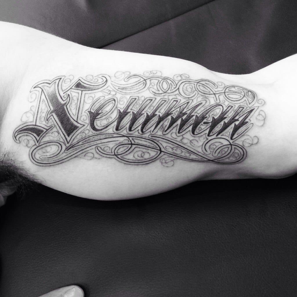 fancy lettering tattoo