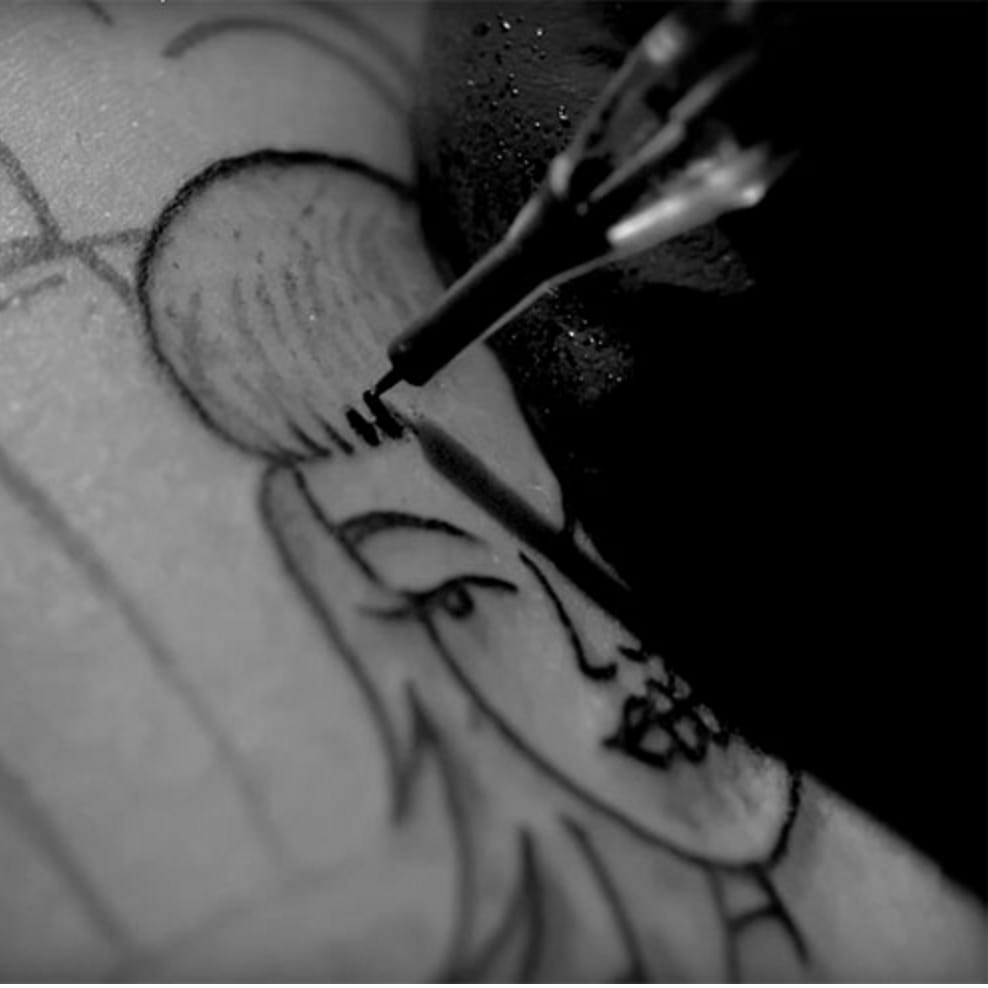 The Slow Motion Tattooing in Atmosphere's New Music Video Is Awesome