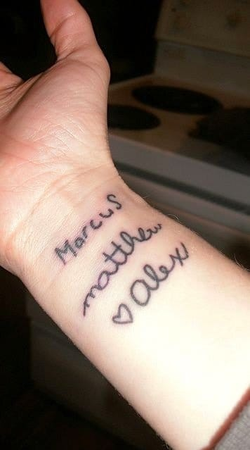 Names of children, tattooed as they wrote them.