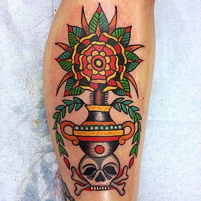 Beautiful flower and skull tattoo