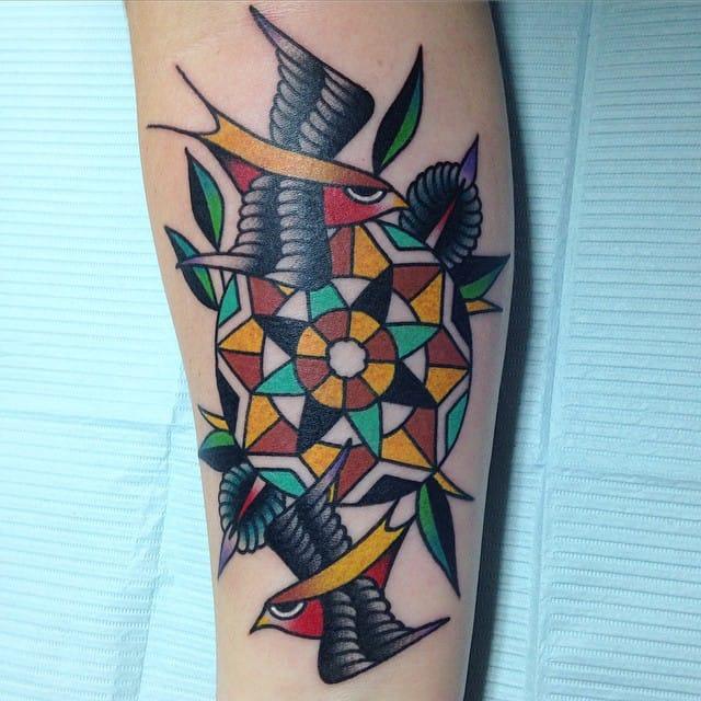 Creative and geometrical flower tattoo