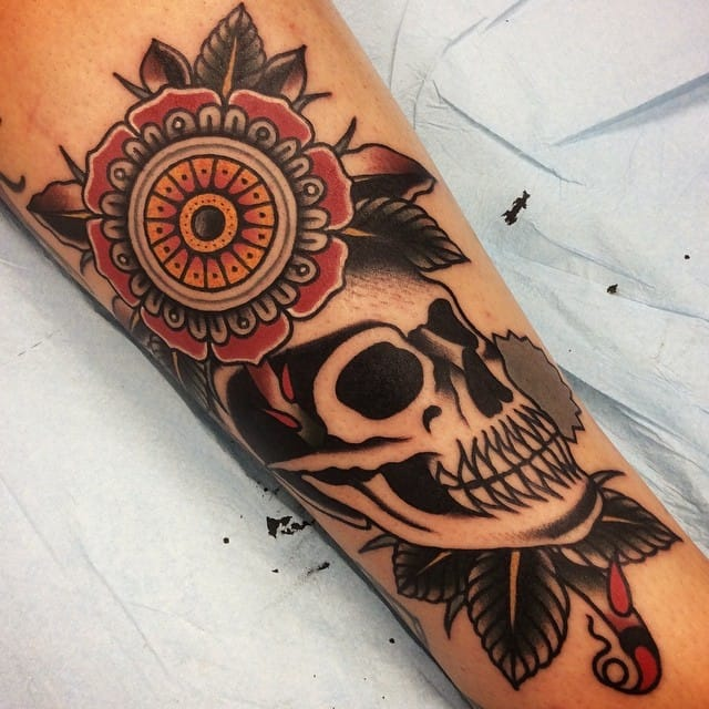 Awesome skull and flower tattoo