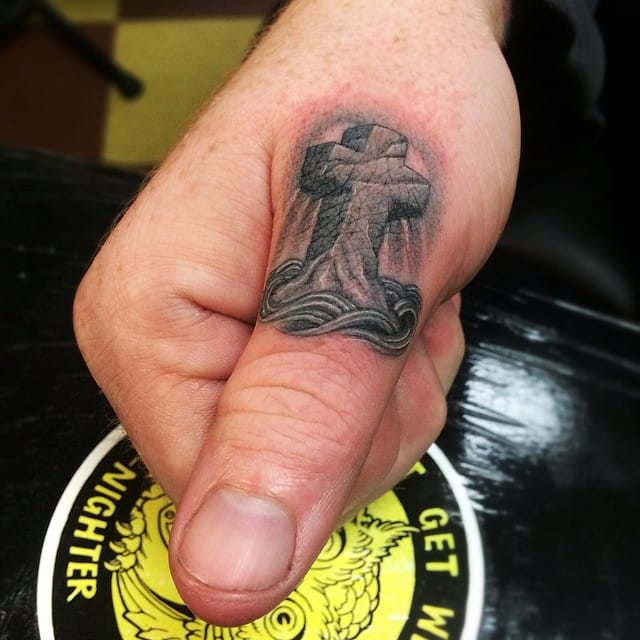 Finger tattoo by Ben Grillo