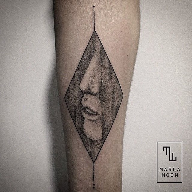 Delicate tattoo by Marla Moon.