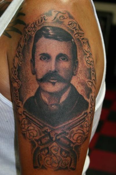 Gunslinger themed tattoo
