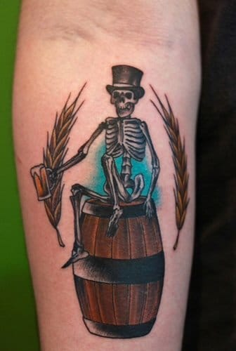 Skeleton and beer tattoo