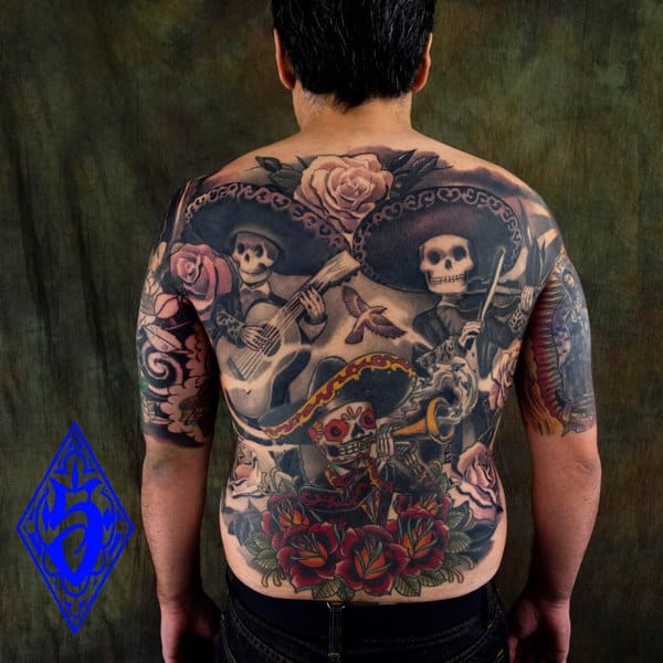 Fun Mexican skeleton tattoos on this backpiece by Kore Flatmo!
