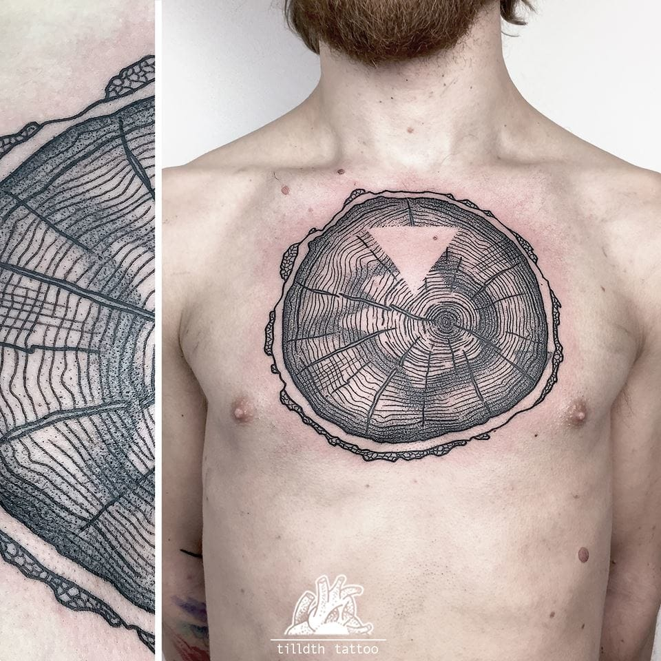 Not keen of inking the whole tree? Get a cross section tattoo! Here by Tilldth.