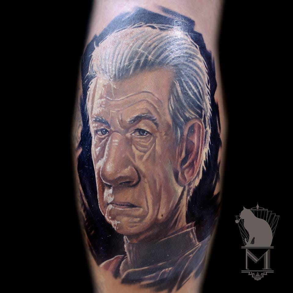 Let start by the best ones. Tattoo artist Maurycy Szymczak has released some great caricature tattoos including this Ian McKellen in X-Men Magneto.