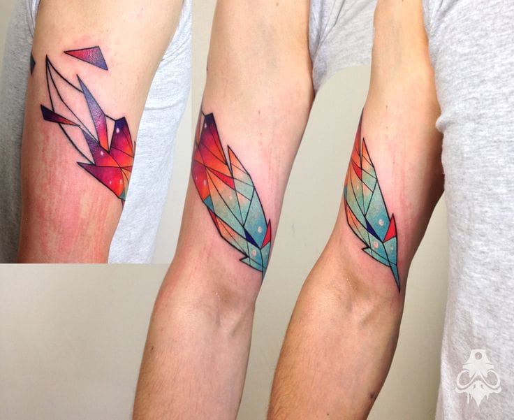 by Carlos Breakone of Fine Heart Custom Ink  #feather #feathertattoo