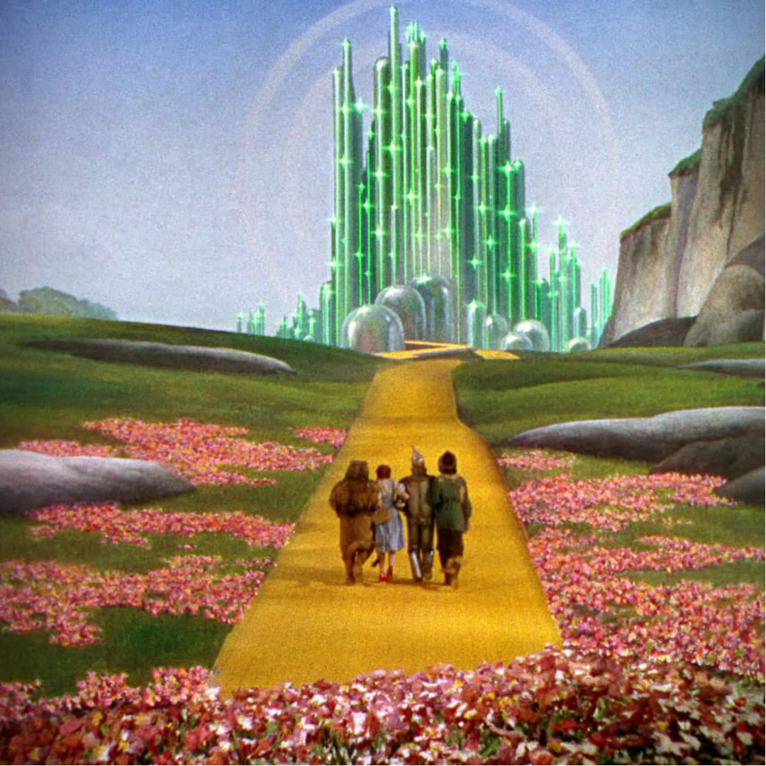 Lion, Dorothy, Tin Man, and Scarecrow on Yellow Brick Road to Oz