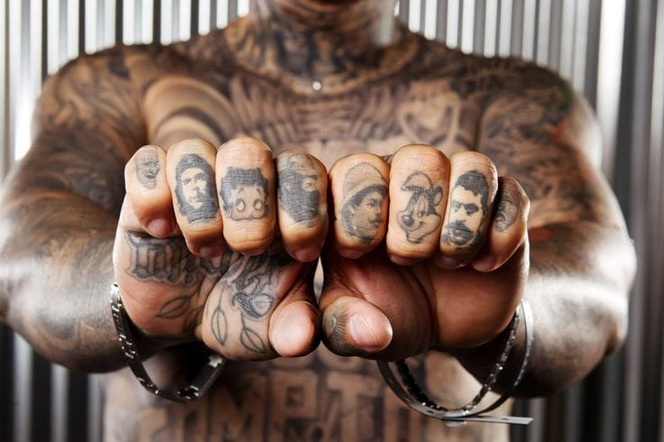 Knuckle tattoos don't always have to be lettering!! This kickass piece proves it