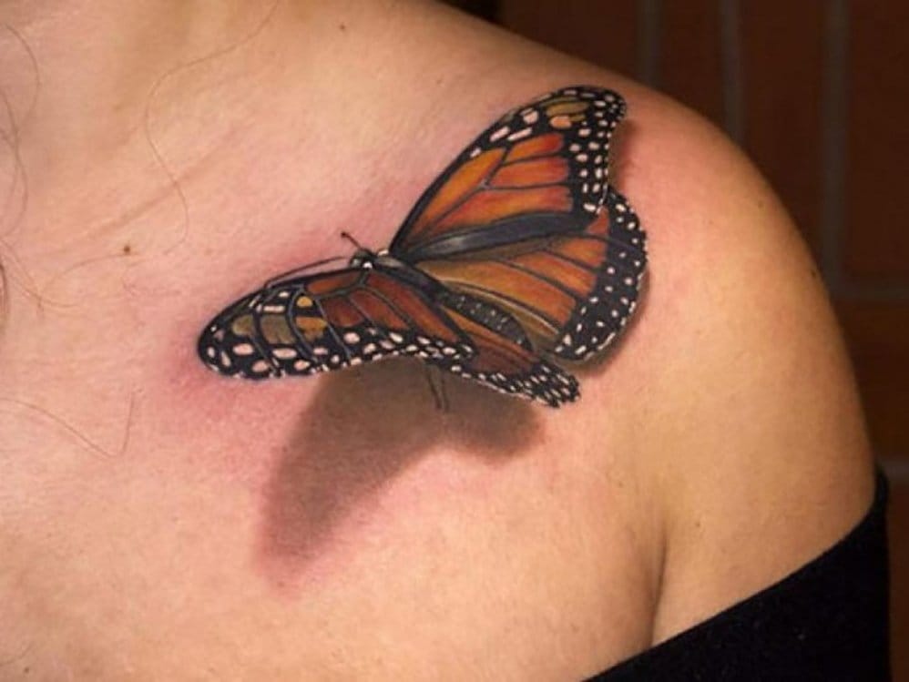 This butterfly tattoo by Lippo Tattoo looks so real!