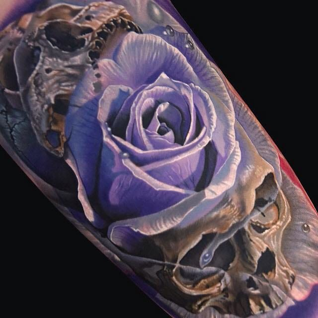 Jaw-dropping rose and skull tattoo by Phil Garcia!