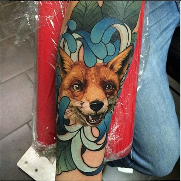 The head of this fox by John Barrett seems to spring out from the rest of the tattoo!