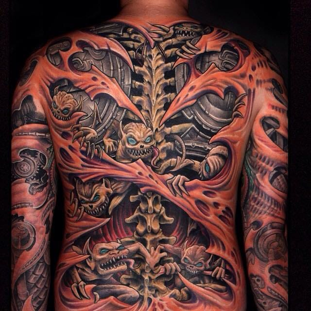 Incredible biomechanical and horror tattoo by Julian Siebert!