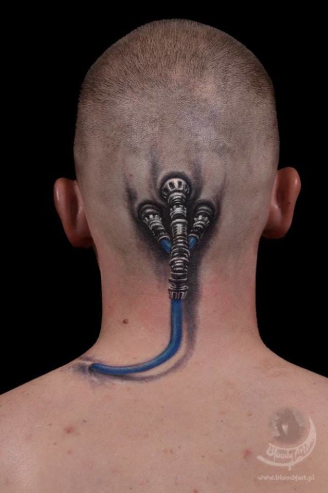 Have you seen the Matrix movie trilogy? Sick tattoo, also by Sebastian Żmijewski!
