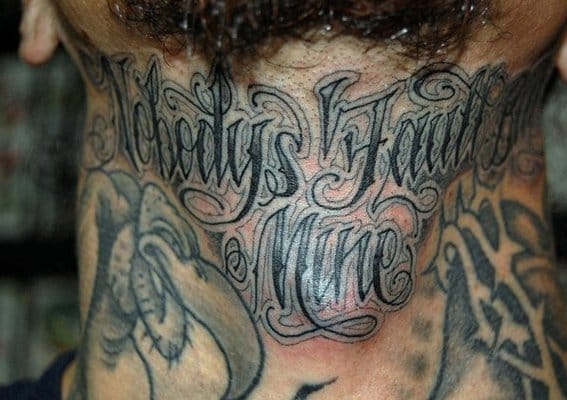 Awesome neck lettering tattoo