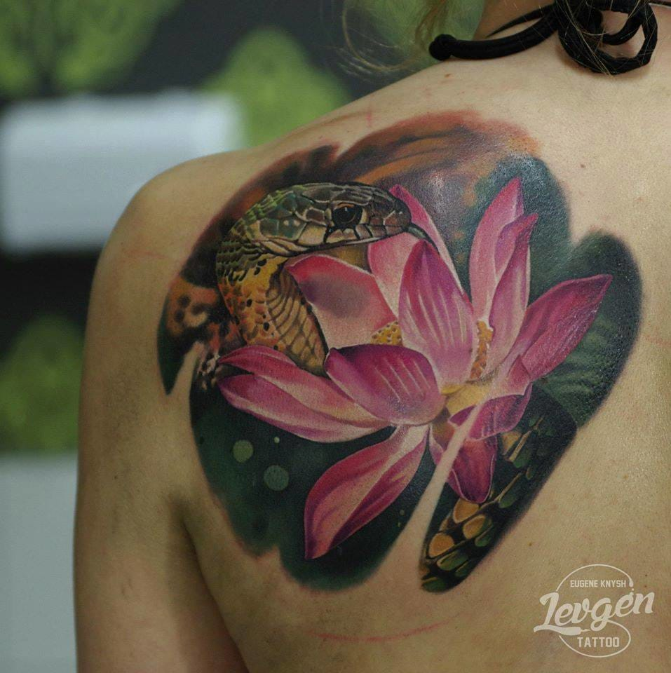 Fantastic lotus and water snake tattoo by Levgen!