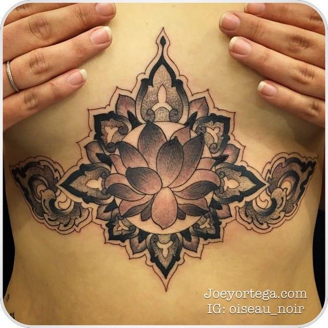 Cool lotus tattoo by Joey Ortega.