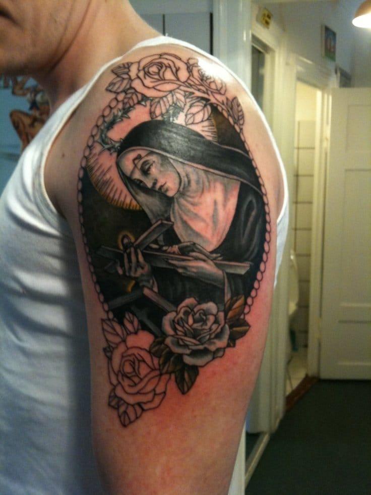 10 timeless saint tattoos tattoodo for Tattoo shops in stl