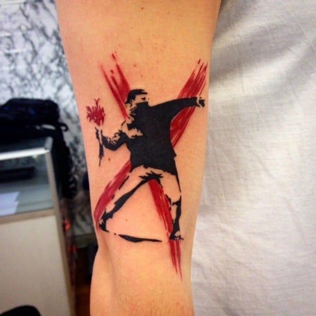 A Bansky original, tattooed by Sandro Secchin Simão