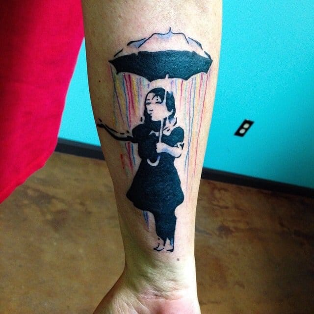 A Banksy original, tattooed by Poby