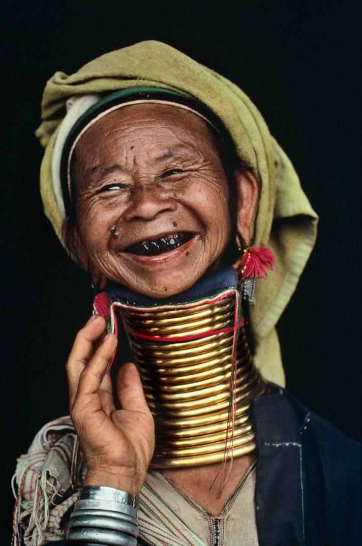 A rarity in Myanmar, a woman models her brass neck rings, Loikaw, Burma (Myanmar), 1994
