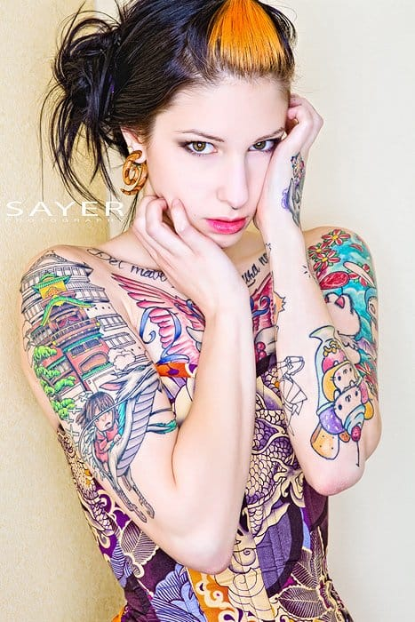 This girl shows a great Spirited Away sleeve with Chihiro riding the dragon Haku (photo by Sayer Photography, model and tattoo artist unknown).