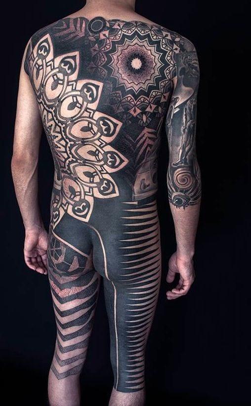 Fantastic blackwork bodysuit by Nazareno Tubaro.