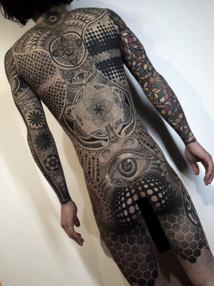 Tattoo artist Nissaco almost broke the internet with his out of this world geometric bodysuit.
