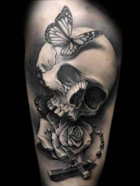 Skull tattoos can also be accentuated with butterflies for a softer, lighter look.