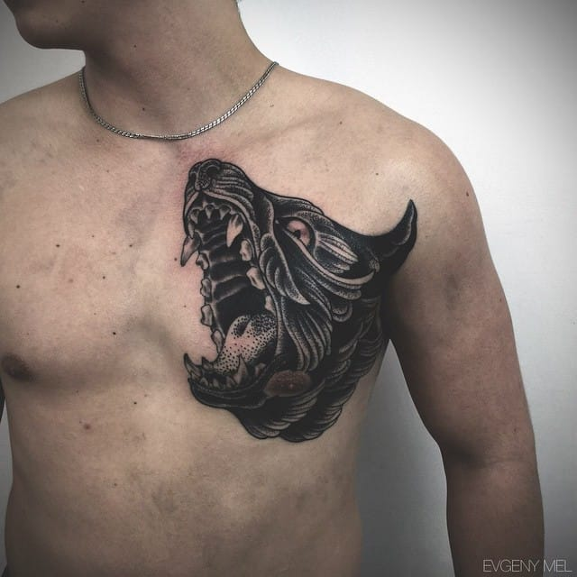 Better not anger the wolf on his skin, nor the one inside that chest! Tattoo by Evgeny Mel
