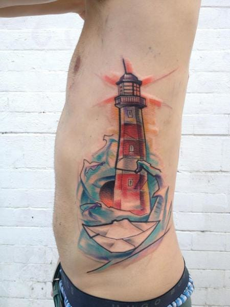 A new take on a traditional subject. Lighthouse tattoo by Voller Konstrat #lighthouse #lighthousetattoo #maritime #artistic #watercolor #VollerKonstrat