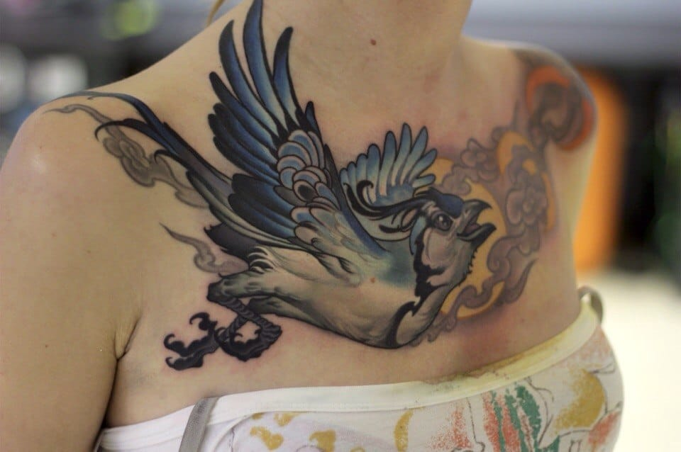 Cool neo traditional chestpiece by Oleg Turianski.