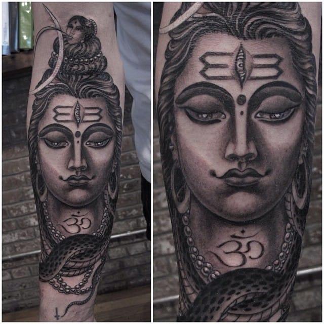 black and grey om tattoo