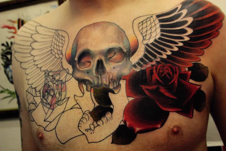 Chest skull tattoos in progress with great 3D effect by English tattoo artist Anthony Flemming. #chest