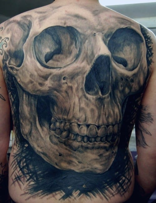 The bigger the better - gigantic skull tattoos look awesome. Tattoo by Blue Dragon Tattoo. #skull