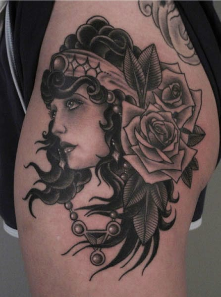 Saved Tattoo did this black and grey gypsy tattoo