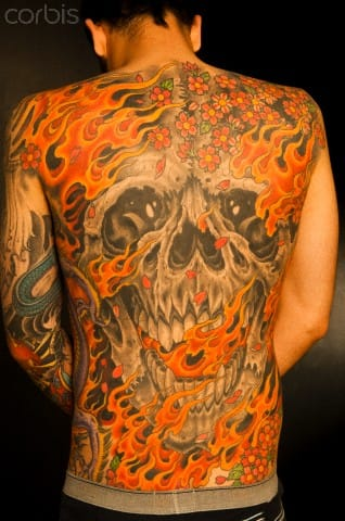 Flamming skull back piece by the master Mike Rubendall. #mikerubendall #skull