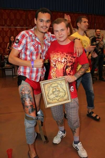 Ilya Fominykh receiving a prize for one of his tattoo in a Russian tattoo convention.