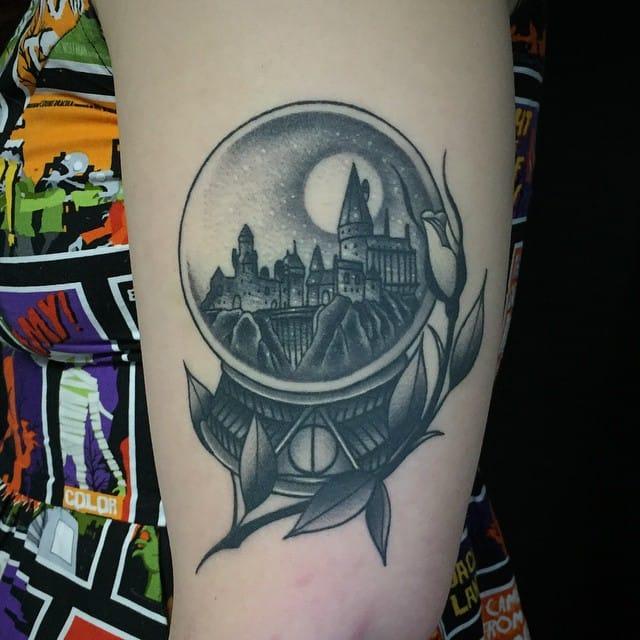 Harry Potter Tattoos - Lovely Hogwarts snowball by Javier Betancourt #HarryPotter #Hogwarts #Hogwartssnowball #snowball #fantattoo #blackwork